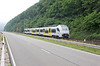 460-0005 heads North at Boppard in the morning mistwith an local stopping train on 13th June 2015