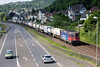 SBB 421-390 heads a well loaded container train South at Linz on 13th June 2015