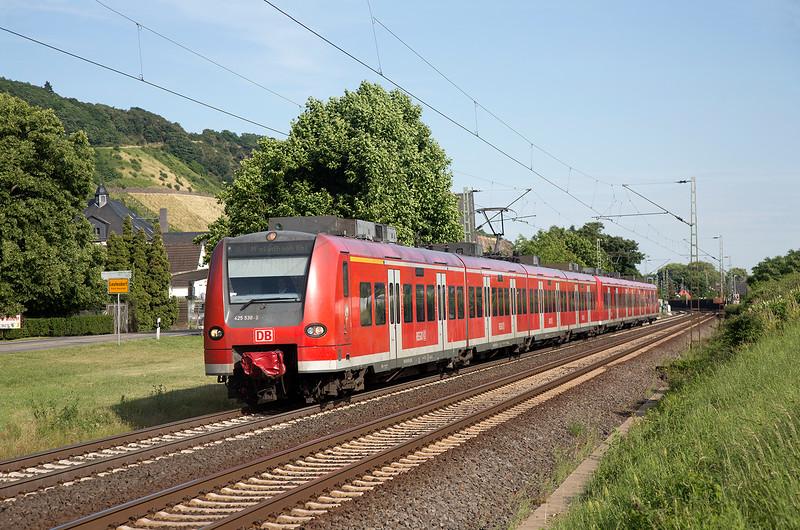 425-530 leads an RE* Koblenz to Moncehengladbach HBF service paste Leutesdorf on 14th June 2015