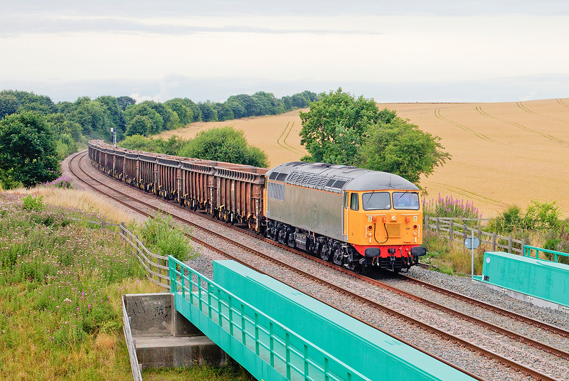 56081 crosses the A6201 near Moorthorpe with the 6Z34 10:02 Stockton to Cardiff Scrap train on 24th July 2015