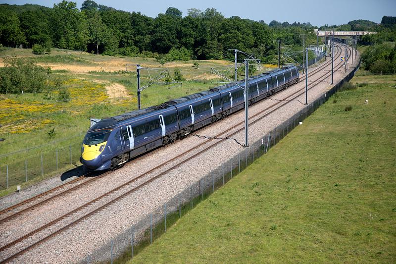 395020 passing Runham Lane near Lenham with the 1J45 16:03 Margate to London St Pancras on 11th June 2015