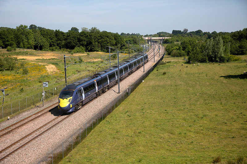 395016 speeds past Runham Lane (near Lenham) towards Ebbsfleet with the 1L44 St Pancras to St Pancras on 11th June 2015