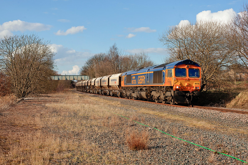 66730 'Whitemoor' rolls past Walton footbridge with a 6E84 08:20 Middleton Towers to Monk Bretton sand train on 23rd March 2015