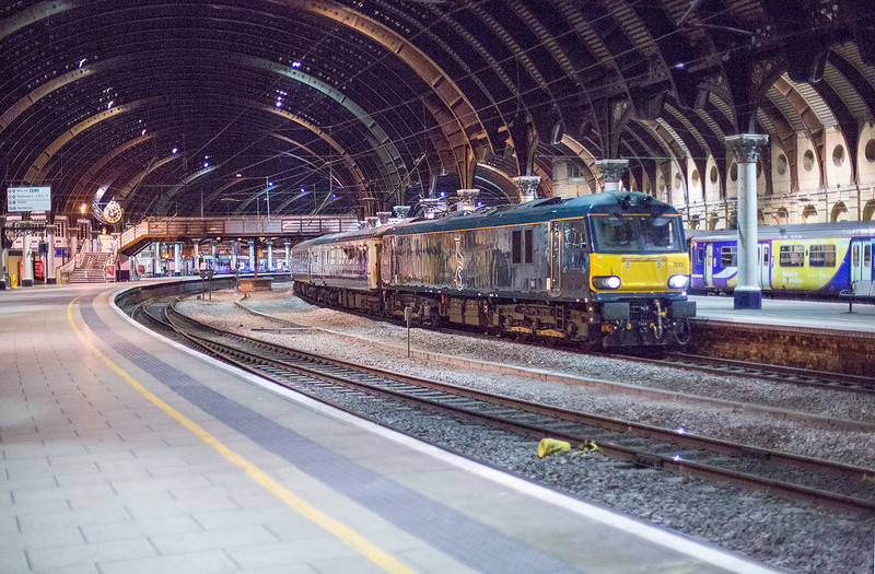 "92033 rolls through York at speed on 25th May 2015 with the diverted 1S26 21:45 London Euston to Glasgow ""beds"""