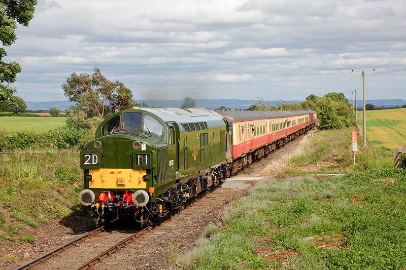 37057 growls past Newton le Willows a little late as Mr Cockburns cloud gathers, wiith the 15:00 Leeming Bar to Redmire on 18th July 2015
