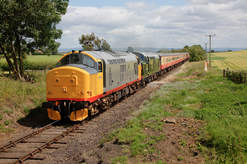 37674+37057 pass Newton le Willows with the 13:00 Leeming Bar to Redmire on 18th July 2015