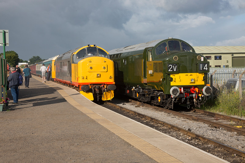37674+67057 standing side by side at Leeming Bar, 37674 ready to depart with the first train of the day the 08:10 to Northallerton West on 18th July 2015