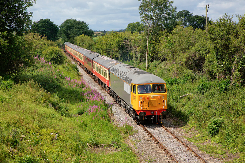 56098 at Crakehall with the 11:45 Redmire to Leeming Bar on 18th July 2015.  Thanks are extended to HMPS Member Cockburn for the tip off with regard to the recent tree clearance.  Thankfully he was busy setting up home re a recent move so no rain today :-)