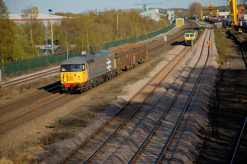 56098 passing Stourton with a 6Z34 14:29 Leicester to Shipley empty Scrap as 66420 arrives with a 4D07 14:48 Tees Port to Stourton on 20th April 2016