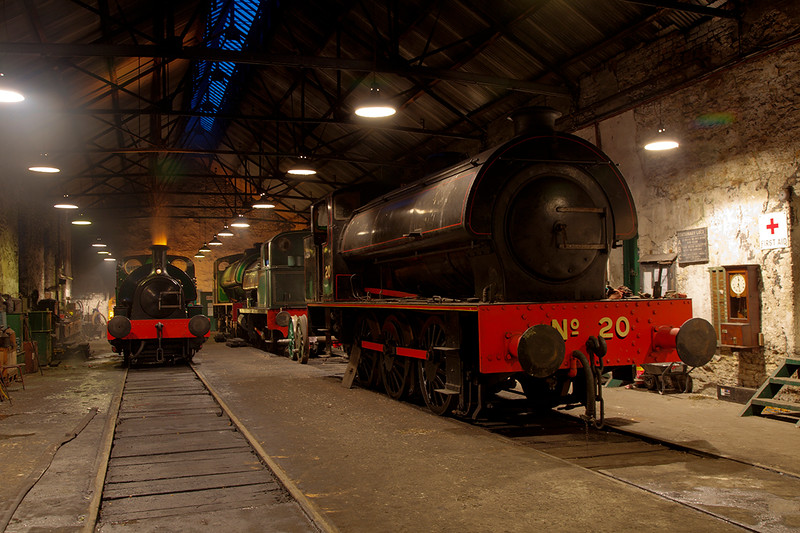 "A general shed view from just inside the door with one engine ""clagging"" away and the orange glow of the forge lighting up the backdrop"