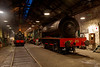 """A general shed view from just inside the door with one engine """"clagging"""" away and the orange glow of the forge lighting up the backdrop"""