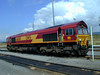 66080-stands-outside-Margam