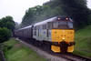 31271 heads for Haworth during a torrential downpour with the 16:00 Oxenhope to Keighley on 20th June 2004