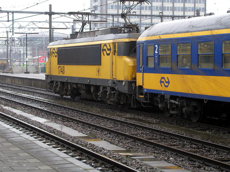 1748 at Amsterdam CS with a Maastricht to Harleem express on 28th November 2002