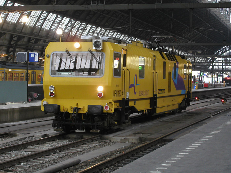 UFM 120 track machine under the train shed roof at Amsterdam on 28th November 2002