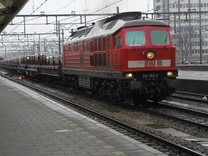 241-353-2 powers a loaded steel train through Amsterdam CS on 28th November 2002