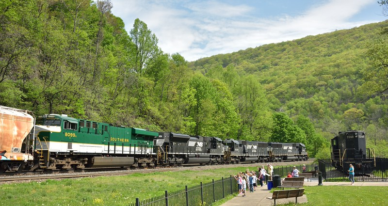 Norfolk Southern SD40 No.6303 / 6328 /SD70 No.1151 and heritage liveried Southern ES44 No.8099 thunder past Horseshoe Curve trackside observation park<br /> <br /> Altoona . PA.<br /> <br /> 11 May 2015