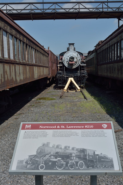 Norwood and St Lawrence 2-6-0 No.210<br /> built in 1923 by ALCO <br /> Unfortunately hemmed in by rakes of coaching stock in the yard.<br /> <br /> Steamtown, Scranton.PA<br /> 10   May 2015