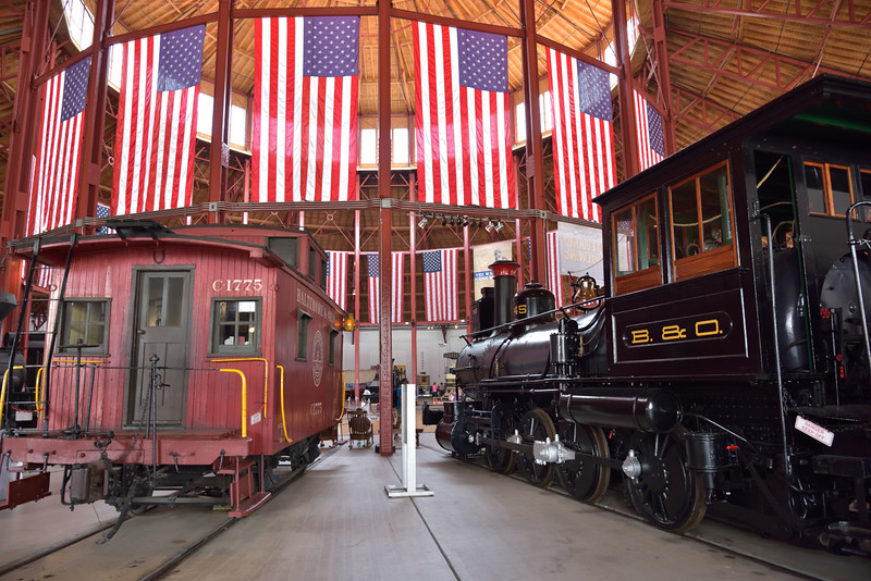 """B&O Class E6 2-8-0 No.545 """"A.J. Cromwell""""<br /> <br /> This loco is the only surviving B&O freight locomotive of its type and stands next to B&O Caboose No. C-1775 in the flag draped roundhouse<br /> <br /> B&O Railroad Museum Baltimore<br /> <br /> 8 May 2015"""