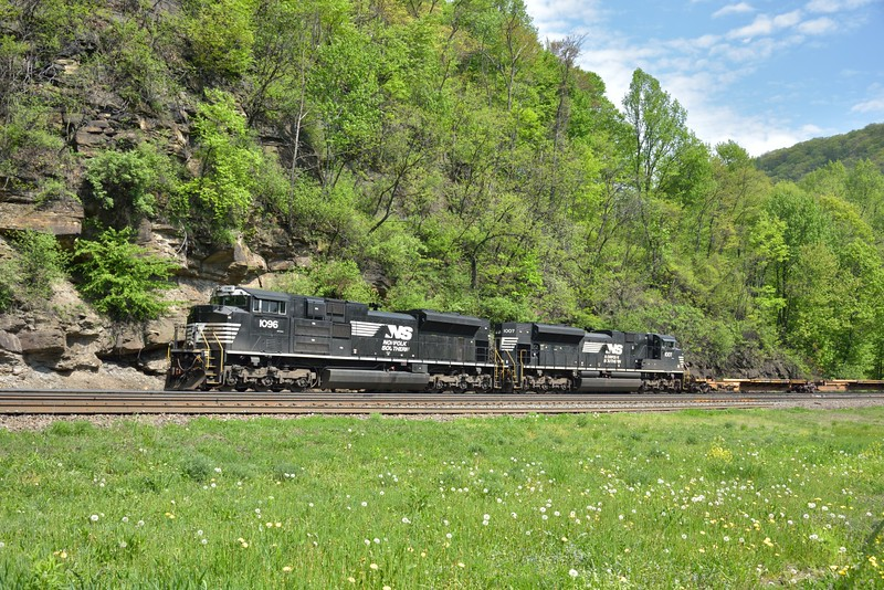 EMD SD70 Nos,1096 / 1007 haul a rake of empty container flts westwards from Altoona.<br /> <br /> Horseshoe Curve Park<br /> Altoona PA.
