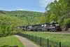 Heavy haul power with SD40E Nos.6303 / 6328 / SD70 No.1151 at the head of a mixed freight heading down to Altoona.<br /> <br /> Horseshoe Curve Park<br /> Altoona PA.