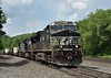 Norfolk Southern ES40s Nos. 7511 / 9620 / 9679 thunder uphill past Carneys Crossing Road<br /> Lilly PA.