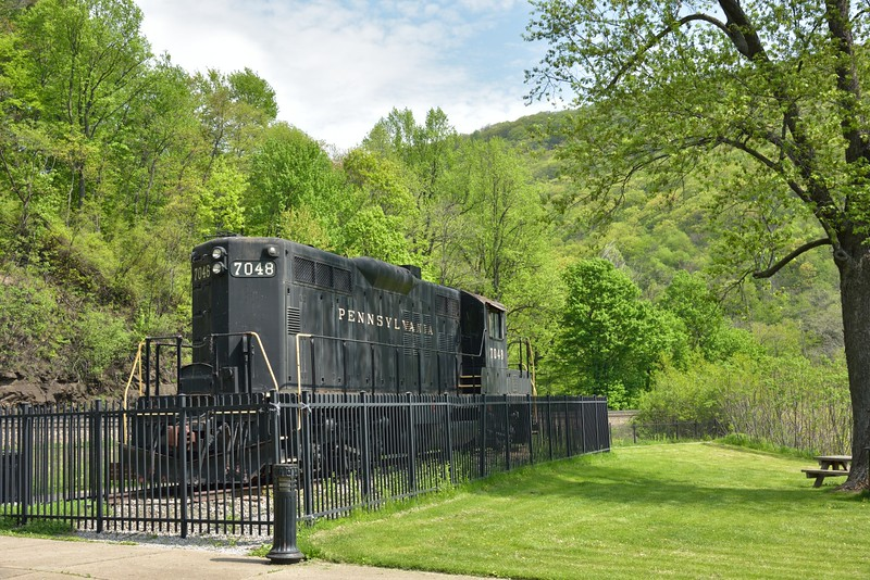 Former Pennsylvania Railroad EMD GP9 No.7048 on static display at the trackside viewing park.<br /> <br /> Horseshoe Curve. Altoona. PA.<br /> <br /> 11 May 2015