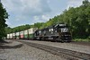 Norfolk Southern SD40s 6306 / 6310  bring up the rear of a long double stacked rake of containers<br /> Seen passing Carneys Crossing Road<br /> <br /> Lilly PA.