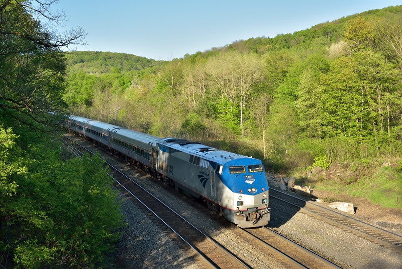 The Pennsylvanian travels daily between New York City and Pittsburgh<br /> Here Amtrack P42DC No.148 heads the evening  return service (43) to Pittsburgh and is seen passing Cassandra Railroad Overlook between Lilly and Portage. PA,.