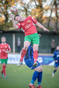 Stephen Bromley gets a header, while being pushed.