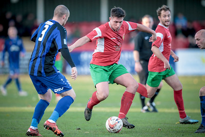 Paul Beesley drags the ball back to try and get around the two Town defenders.