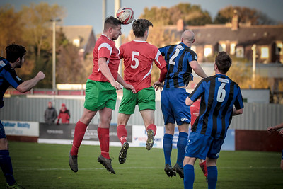 Paul Beesley wins another header in the Cleepthorpes Town box.