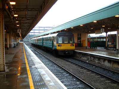142002 rests with a sister Arriva unit at Cardiff Central on the 7th December 2006