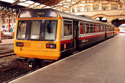 142011 stands at Manchester Victoria on the 12th May 2000