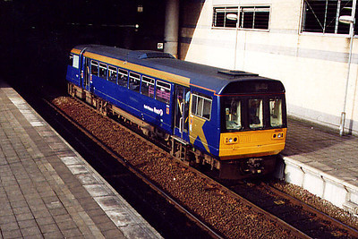 142023 leaves Manchester Victoria on the 14th March 2001