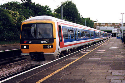 165107 storms through Ealing Broadway on the 23rd June 1999
