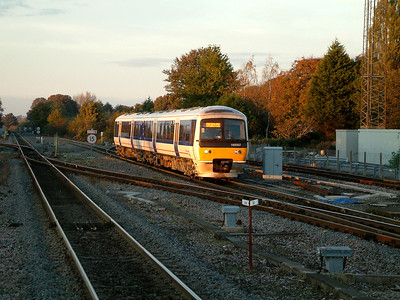 165007 catches the late Autumn sunlight as it arrives at Princes Risborough on the 4th November 2006