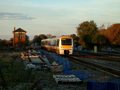 168109 catches the last rays of the late afternoon sun as it heads away from Princes Risborough on the 4th November 2006