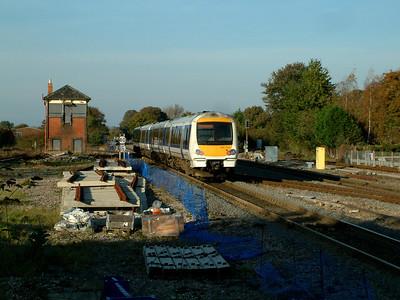 168215 passes redundant signalbox at Princes Risborough on the 4th November 2006