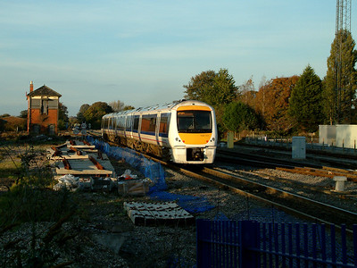 168111 is dodges shadows as it leaves Princes Risborough on the 4th November 2006