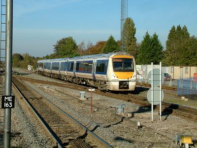 168113 rushes south through Princes Risborough on the 4th November 2006