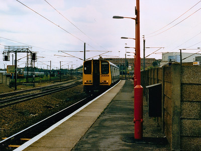 313058 arrives at Hornsey during Spring/Summer 1986