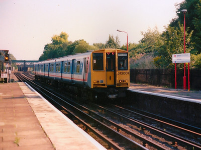 313007 shows off it's early Network SouthEast colours as it arrives at Kenton during Summer 1989