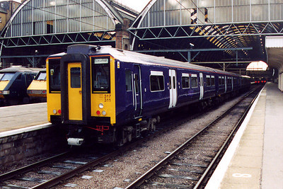 317311 at London Kings Cross on the 15th December 2001