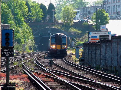 444011 emerges from the tunnel at the east end of Southampton Central on the 2nd May 2007