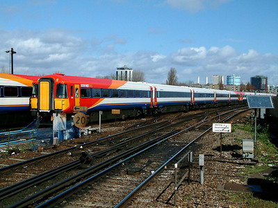 2401 gleams in the sunlight as it passes through Clapham Junction on the 2nd April 2006