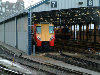 8021 shelters from the rain, with 444023, in the shed at Clapham Yard on the 2nd April 2006
