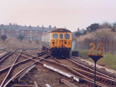 65448 arrives at Bury Interchange during Spring 1986