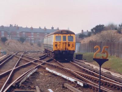 65448 arrives at Bury Interchange during Spring 1986