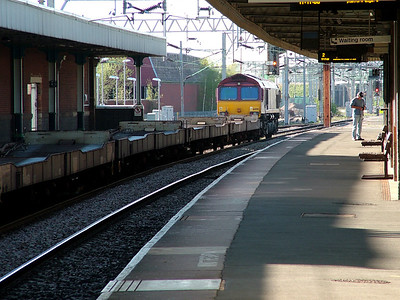 66001 runbles through Nuneaton with a train of Ford cars on the 19th April 2007